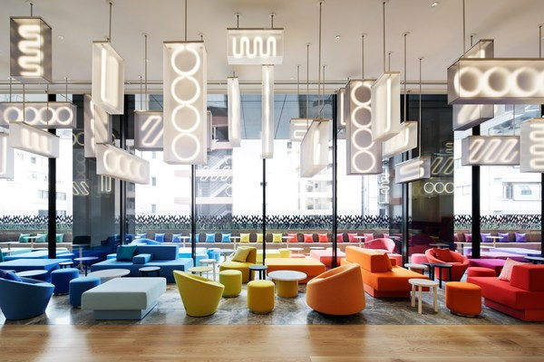 The hotel's social hub LIVING ROOM (W's signature take on the lobby) greets guests with vivid colors.