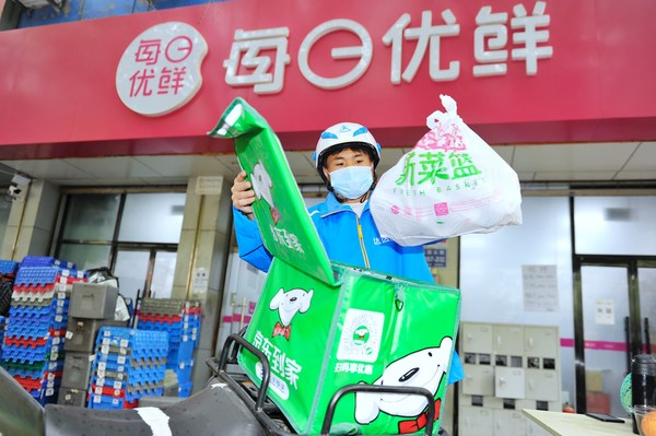 A Dada Now rider picked up orders at the Miss Fresh's store